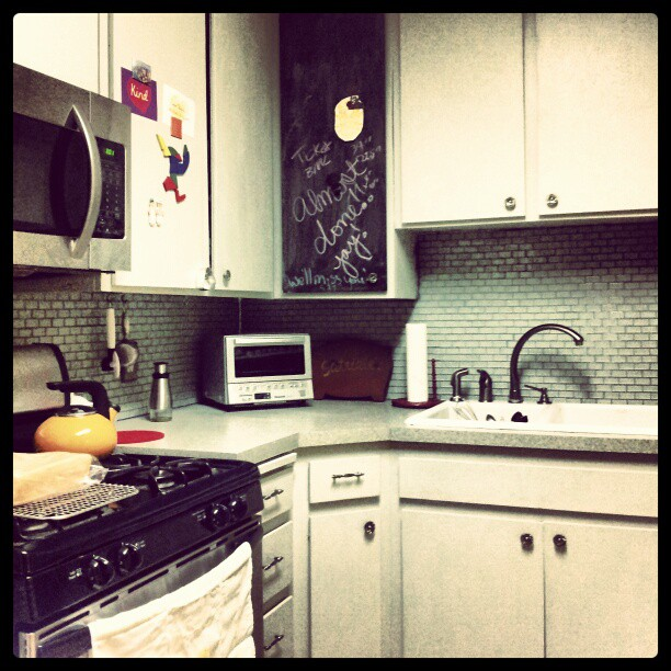 New sink, updates cabinets, new toaster, new microwave. The cabinet with to the right of the stove has magnetic paint. The black cabinet was painted with magnetic and chalkboard paint.
